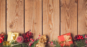 Christmas holiday wooden background with decorations and ornaments. Stock Images