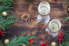 Christmas holiday wooden composition with champaign, pine branch Royalty Free Stock Image