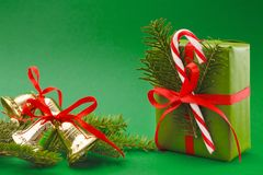 Christmas holiday wrapped gift box on green background Royalty Free Stock Photos