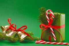 Christmas holiday wrapped gift box on green background Stock Image