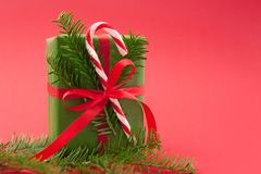 Christmas holiday wrapped gift box on light red background Stock Photography
