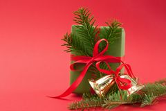 Christmas holiday wrapped gift box on light red background Stock Photo