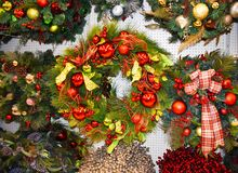 Christmas Holiday Wreaths. Many holiday wreaths hanging on a wall Royalty Free Stock Images