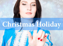 Christmas holiday written on virtual screen. concept of celebratory technology in internet and networking. woman in Stock Image