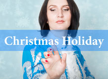 Christmas holiday written on virtual screen. concept of celebratory technology in internet and networking. woman in Royalty Free Stock Photography