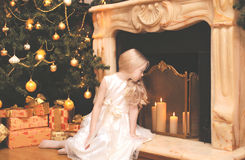 Christmas, holiday, xmas concept - happy little girl with gifts Stock Images
