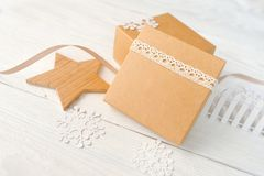 Christmas holidays background with festive decorations and gift boxes on white wooden board with copy space for your stock image