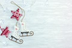 Christmas holidays background with small decorative skates and g stock images