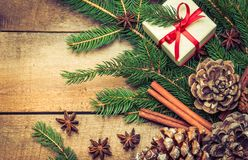 Christmas holidays background text space. Christmas or new year holidays background text space.Branch of christmas tree and gift on rustic wood Royalty Free Stock Photography