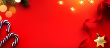 Christmas holidays composition on red background with copy space for your text stock image