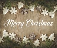 Christmas holidays composition on wooden background with inscription Merry Christmas. Christmas card. Top view. Holiday concept royalty free stock photo