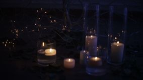 Candles burning under a decorated tree with roses. Christmas holidays. Christmas holidays decorations. Candles burning under a decorated tree with roses stock footage