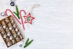 Christmas holidays decorations on wooden background with glass b royalty free stock image