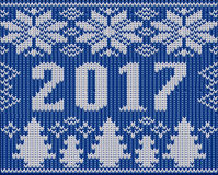 Christmas holidays fragment with 2017 New Year knitted texture Royalty Free Stock Photography
