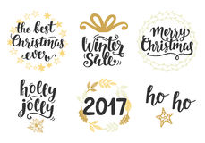 Christmas holidays hand lettering set. Isolated on white. Merry Christmas, Winter Sale, 2017, Holly Jolly. Typography design elements for greeting cards Stock Image