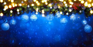 Christmas holidays light and Christmas tree composition on blue royalty free stock photography