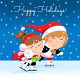Christmas holidays - lovely little girls in winter outfit ice skating - snowy night Stock Photos