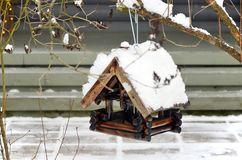Feeder for winter birds in the snow. royalty free stock photo