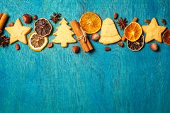 Christmas holidays ornament made from home made cookies and trad. Itional festive spices on wooden blue background, flat lay with copy space stock image