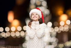Dreaming girl in santa helper hat Royalty Free Stock Photography