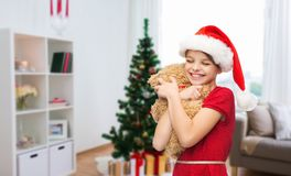 Happy girl with teddy bear at christmas Royalty Free Stock Photo