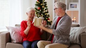 Happy smiling senior couple with christmas gift stock video