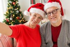 Happy senior couple taking christmas selfie Royalty Free Stock Image
