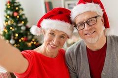 Happy senior couple taking christmas selfie Stock Image