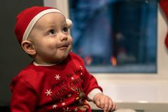 Christmas, holidays and people concept - little baby boy in santa hat royalty free stock photos