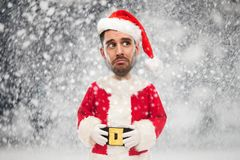 Sad man in santa claus costume over christmas snow Stock Photos