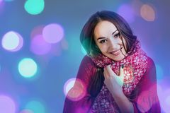Christmas holidays Smiling girl red scarf shining background new year. Winter christmas holidays Smiling girl red scarf shining background new year Royalty Free Stock Photography
