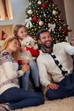 Christmas, holidays, technology and people concept- family takin Stock Image