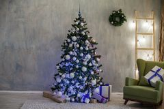 Christmas holidays with Christmas tree decor gifts royalty free stock photos