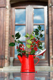Christmas hollies in vase Stock Photo