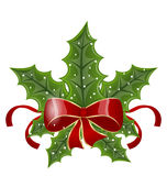 Christmas holly berry branches and bow Royalty Free Stock Images