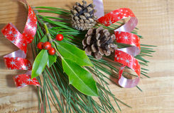 Christmas holly berry with red berries on wood Stock Image
