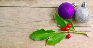 Christmas holly berry with red berries on wood Royalty Free Stock Photos