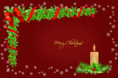 Christmas holly border decoration with candle and snowflakes over red background, greeting card Royalty Free Stock Photography