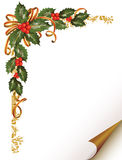 Christmas holly branch in the corner Royalty Free Stock Photography