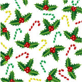 Christmas holly and candy Stock Photography