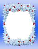 Christmas Holly Frame. Christmas border or frame of snow-covered holly leaves and berries Royalty Free Stock Images