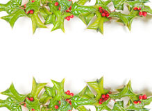 Christmas holly frame isolated stock images