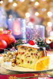 Christmas holly fruitcake on the decorated table Royalty Free Stock Image