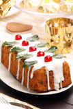 Christmas holly fruitcake on the table Royalty Free Stock Photo