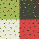 Christmas holly patterns Royalty Free Stock Images