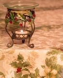 Christmas Holly Tablecloth and Candle Royalty Free Stock Photo
