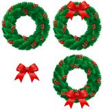 Christmas holly wreath. Vector set of christmas decorations - holly wreath with berries and bow isolated on white background Royalty Free Stock Image