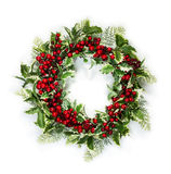 Christmas holly wreath. Christmas wreath of holly berries and leaves isolated on white background stock images