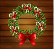 Christmas holly wreath in wood background Royalty Free Stock Images