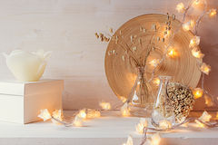 Christmas home decoration with burning lights on white wooden background. stock images